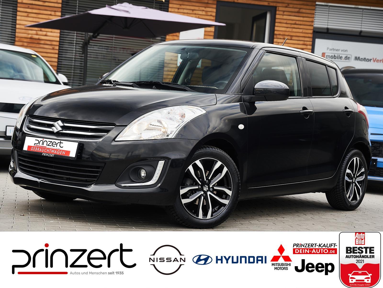 Suzuki Swift 1.2 MT Teilleder Tempomat Allwetter, Jahr 2015, Benzin
